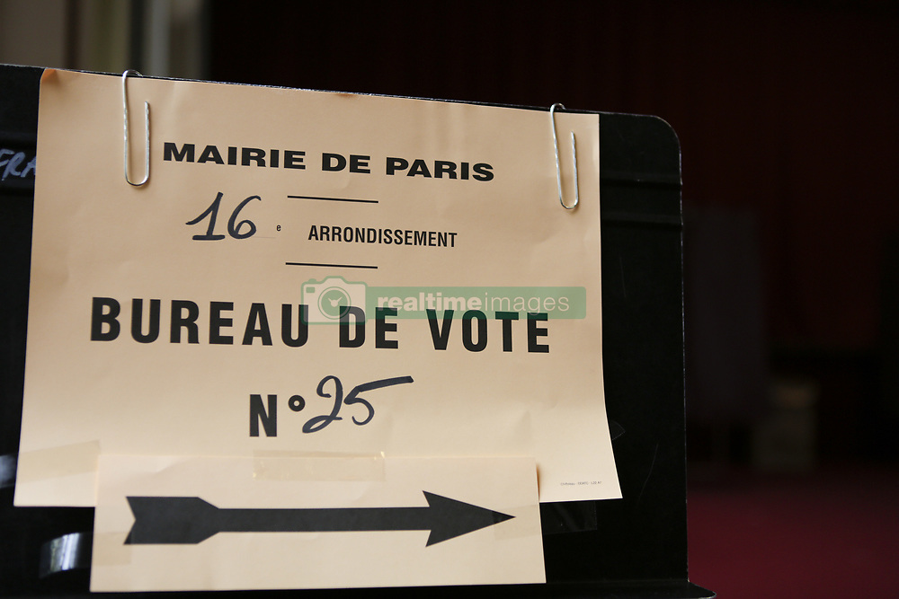 May 7, 2017 - Paris, Ile-de-France, France - Signs lead the electors to the correct polling station. Around 47 Million French people are called to the ballot boxes to elect the next President of France. The independent candidate Emmanuel Macron is expected to take the win over his rival Marine Le Pen from the  right wing National Front. (Credit Image: © Michael Debets/Pacific Press via ZUMA Wire)