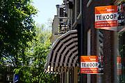 Te koop borden bij een huis in Utrecht
