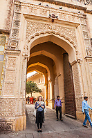 A western tourist woman at the gates to Mehrangarh Fort, Jodhpur, Rajasthan, India.