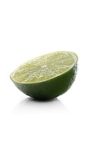 Halved lime on white background