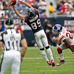 October 10, 2010; Houston, TX USA; Houston Texans wide receiver David Anderson (89) reaches for a ball as New York Giants cornerback Corey Webster (23) defends the play during the second half at Reliant Stadium. The Giants defeated the Texans 34-10. Mandatory Credit: Derick E. Hingle