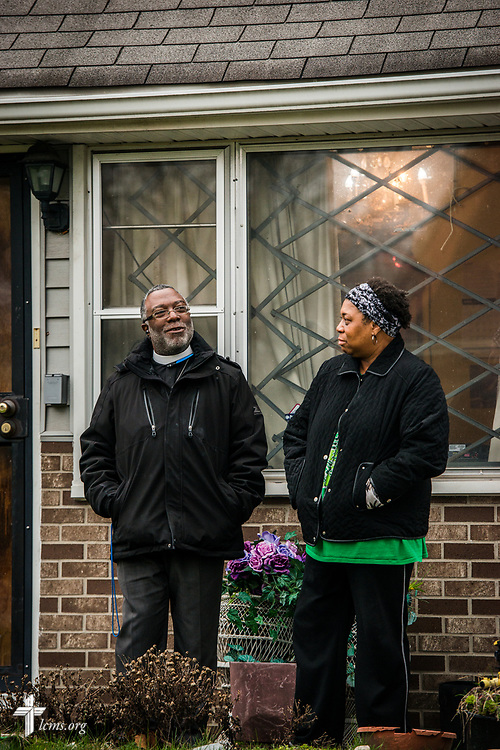 The Rev. Delwyn Campbell, national missionary to Gary, Ind., witnesses with Melody Jefferson at a home in Gary on Wednesday, April 5, 2017. LCMS Communications/Erik M. Lunsford