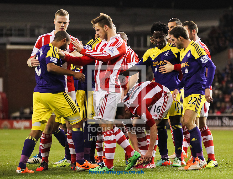 Stoke City and Swansea City players get in a scuffle during the Barclays Premier League match at the Britannia Stadium, Stoke-on-Trent<br /> Picture by Tom Smith/Focus Images Ltd 07545141164<br /> 12/02/2014