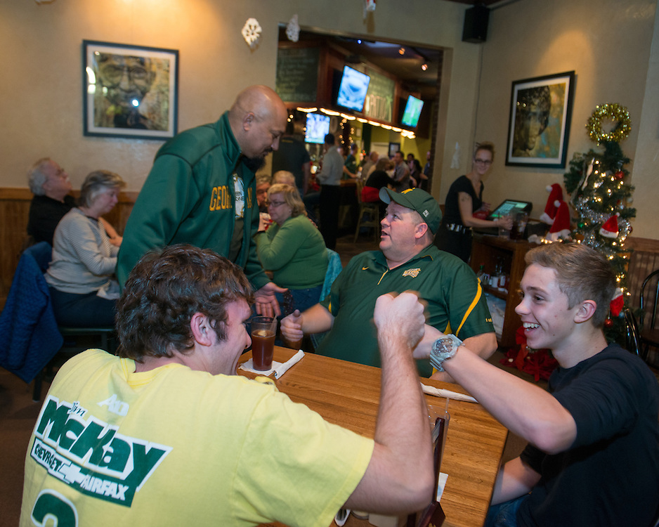 December 5, 2015 - Fairfax, VA - A day in the life of &quot;Doc Nix,&quot; aka Dr. Michael Nickens, the Director of the Athletic Bands for George Mason University. Here he talks to a coach after the game at Brion's.<br /> <br /> Photo by Susana Raab