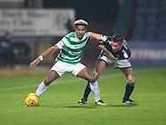 20th September 2017, Dens Park, Dundee, Scotland; Scottish League Cup Quarter-final, Dundee v Celtic; Celtic's Scott Sinclair holds off Dundee's Cammy Kerr