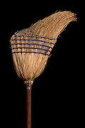 an old intense used straw broom