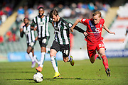 Plymouth Argyle's Graham Carey and York City's Luke Hendrie battle for the ball during the Sky Bet League 2 match between Plymouth Argyle and York City at Home Park, Plymouth, England on 28 March 2016. Photo by Graham Hunt.