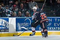KELOWNA, CANADA - MARCH 25: Lane Bauer #25 of the Kamloops Blazers checks Cal Foote #25 of the Kelowna Rockets during second period on March 25, 2017 at Prospera Place in Kelowna, British Columbia, Canada.  (Photo by Marissa Baecker/Shoot the Breeze)  *** Local Caption ***