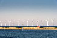 Windmills in the sea off the coast of Copenhagen in Denmark