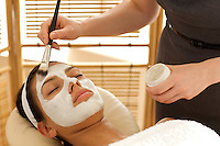 Close-up of young woman receiving beauty treatment in spa