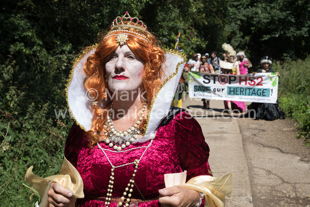Environmental activists in period costume from groups opposed to the HS2 high-speed rail link restage a historical 1602 visit by Queen Elizabeth I to Dews Farm on 31st July 2020 in Harefield, United Kingdom. The activists tried to retrace the steps of Queen Elizabeth I from St Mary's church to Dews Farm in order to pay their respects to Anne and Ron Ryall, 73 and 72, on the day of their eviction from Dews Farm by HS2 after having spent nine years and their life savings renovating their £1m dream home, but found their path blocked by HS2 fences and security guards. (photo by Mark Kerrison/In Pictures via Getty Images)