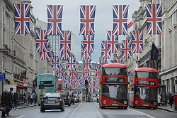 April 27, 2018 - London, UK - LONDON, UK.  Union flags decorate Regent Street ahead of the upcoming Royal wedding of Prince Harry and Meghan Markle. (Credit Image: © Stephen Chung/London News Pictures via ZUMA Wire)