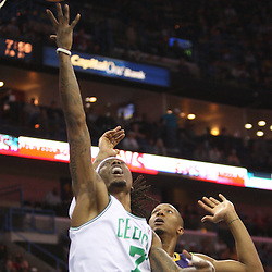 Feb 10, 2010; New Orleans, LA, USA; Boston Celtics guard Marquis Daniels (7) shoots past New Orleans Hornets forward David West (30) during the first half at the New Orleans Arena. Mandatory Credit: Derick E. Hingle-US PRESSWIRE