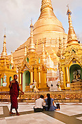 Worshipping at the Shwedagon Pagoda, Yangon, Myanmar.