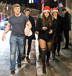© Licensed to London News Pictures. 20/12/2014. Revellers enjoy a night out in Soho, central London, to celebrate the start of the Christmas holidays. The last Friday before Christmas is also known as Mad Friday, which is one of the busiest nights of the year with millions descending into bars and pubs for some festive fun. Photo credit : Isabel Infantes / LNP