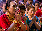 19 OCTOBER 2018 - BANGKOK, THAILAND: People pray at a Navratri altar on Silom Road in Bangkok. Navratri is a nine night (10 day) long Hindu celebration that marks the end of the monsoon and honors of the divine feminine Devi (Durga). The festival is celebrated differently in different parts of India, but the common theme is the battle and victory of Good over Evil based on a regionally famous epic or legend such as the Ramayana or the Devi Mahatmya. Navratri is celebrated throughout Southeast Asia in communities that have a large Hindu population. Because Navratri honors the feminine Devi, Navratri is especially popular with Thai women and transgendered people.   PHOTO BY JACK KURTZ