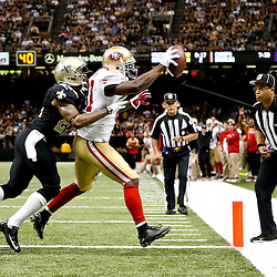 Nov 17, 2013; New Orleans, LA, USA; San Francisco 49ers wide receiver Anquan Boldin (81) catches a touchdown over New Orleans Saints cornerback Corey White (24) during the second quarter of a game at Mercedes-Benz Superdome. Mandatory Credit: Derick E. Hingle-USA TODAY Sports