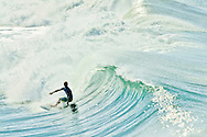Surfer, looking into the barrel of a large wave, Huntington Beach, California