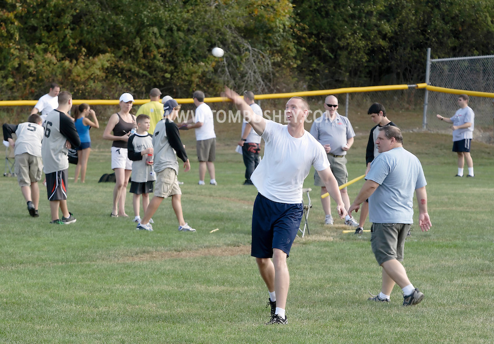 Scotchtown, New York - Corporate challenge teams gather on the field before playing in the Wiffle for Kids charity Wiffle Ball tournament at the Town of Wallkill Little League fields on Sept. 25, 2010.
