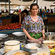 Woman selling honey in Khiva market