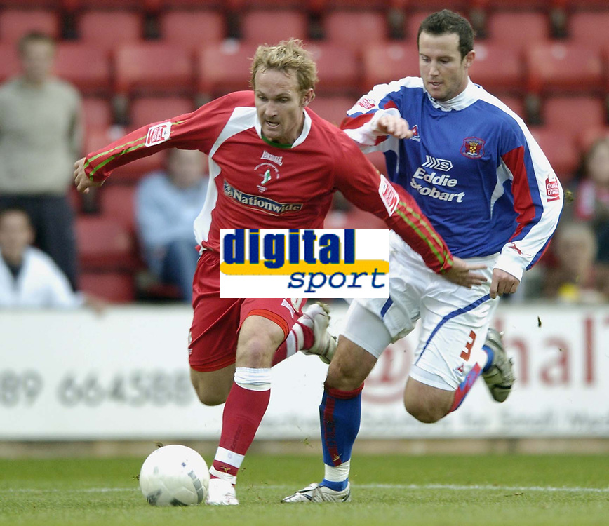 Photo: Jonathan Butler.<br />Swindon Town v Carlisle United. The FA Cup. 11/11/2006.<br />Royce Brownlie of Swindon is held back by Peter Murphy of Carlisle.
