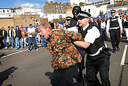 UK, Margate. The completion and burning of Antony Gormley's Waste Man as part of the Exodus Festival and 'Exodus Day' film in Margate in Kent. 'Exodus Day' is a film commissioned and produced by Art Angle and written and directed by Penny Woolcock..Photo shows scenes from the film showing 'undesirables' being rounded up by the 'police'..Photo©Steve Forrest/Workers Photos