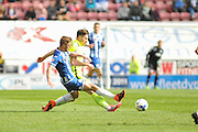 Wigan Midfielder Michael Jacobs tackles Southend United defender, Ryan Leonard (18) during the Sky Bet League 1 match between Wigan Athletic and Southend United at the DW Stadium, Wigan, England on 23 April 2016. Photo by John Marfleet.
