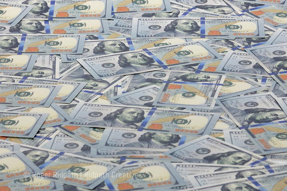 American $100 bills paper money spread out Benjamin Franklin