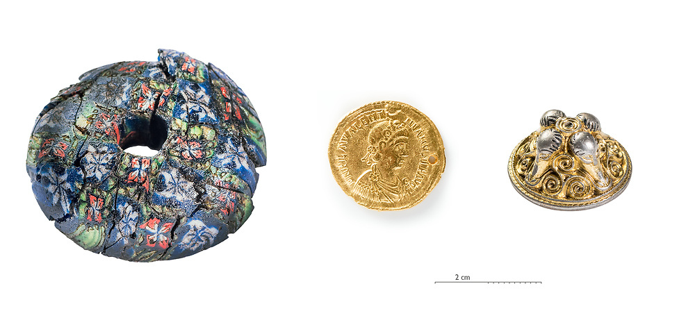 Trio of artifiacts found at Sandby Borg: a millifiori, a solidi and a sword cap