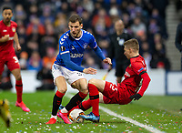 Football - 2019 / 2020 UEFA Europa League - Round of Sixteen, First Leg: Rangers vs. Bayer 04 Leverkusen<br /> <br /> Borna Barisic of Rangers vies with Mitchell Weiser of Bayer Leverkusen, at Ibrox Stadium, Glasgow.<br /> <br /> COLORSPORT/BRUCE WHITE