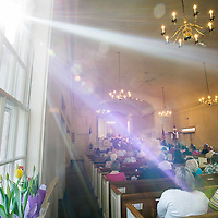 Morning sunlight streams through a window of Mount Calvary Lutheran Church during the Erie, Pa. church's 10:30 a.m. Easter service on Sunday, March 27, 2016, in Erie. Photo by Andy Colwell/Erie Times-News