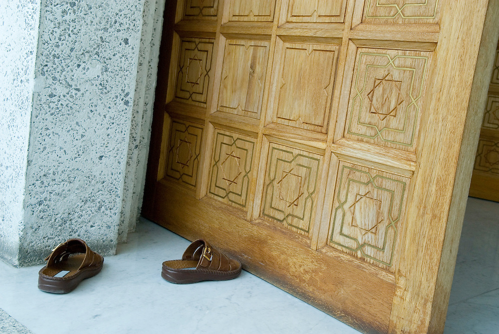 Bahrain - a pair of sandals infront of the entrance to a Mosque
