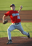 TinCaps pitcher Mike Watt (18) delivers at pitch in the first inning of game three of the Midwest League Championship at Community Field in Burlington, Iowa on September 17, 2009.