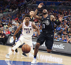 November 14, 2018 - Orlando, FL, USA - The Orlando Magic's Jonathon Simmons (17) screams as he is fouled by the Philadelphia 76ers' Jimmy Butler (23) at the Amway Center in Orlando, Fla., on Wednesday, Nov. 14, 2018. (Credit Image: © Stephen M. Dowell/Orlando Sentinel/TNS via ZUMA Wire)