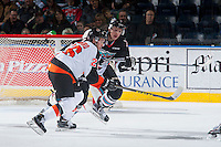 KELOWNA, CANADA - DECEMBER 4: Cole Sanford #26 of Medicine Hat Tigers checks Gordie Ballhorn #4 of Kelowna Rockets on December 4, 2015 at Prospera Place in Kelowna, British Columbia, Canada.  (Photo by Marissa Baecker/Shoot the Breeze)  *** Local Caption *** Cole Sanford; Gordie Ballhorn;