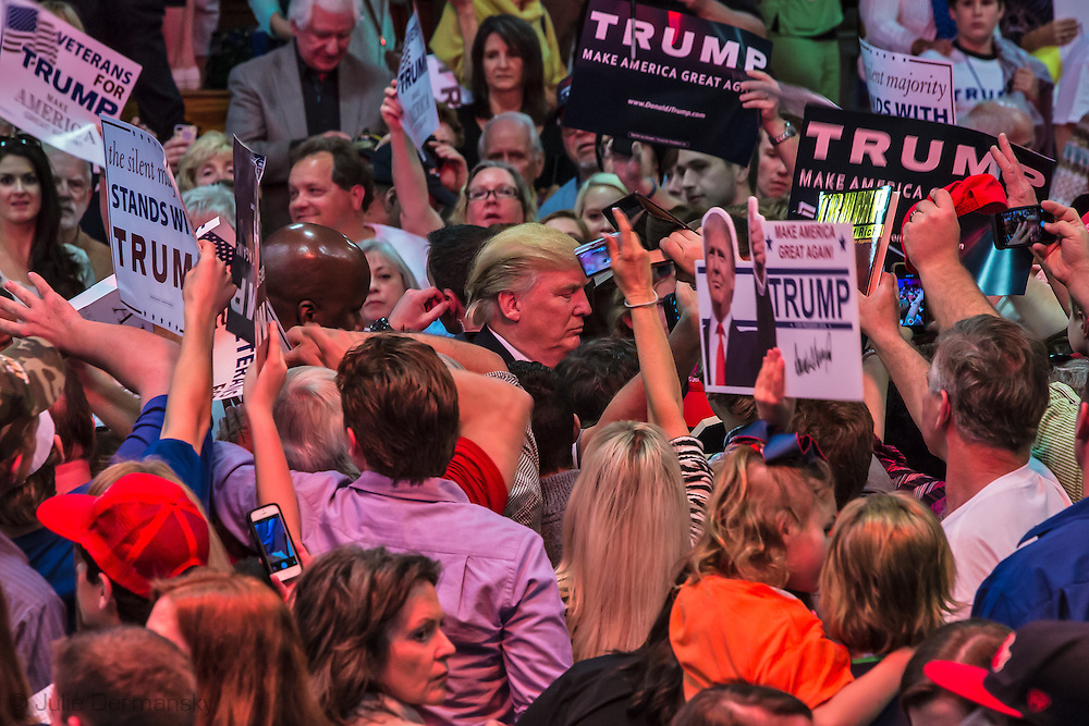 Madison, Mississippi, March 7, 2016 Republican presidential candidate Donald Trump mixes with his fan after speaking at a campaign rally the day before Mississippi primary.