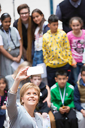 Pictured:  First Minister Nicola Sturgeon<br /> <br /> Scotland's First Minister, Nicola Sturgeon, MSP, carry on with her pubklic duties today without any visible sign of additional security. Ms Sturgeon attended as part of the judging panel as the pupils of Annette Street and St Bride's Primary schools had been involved in a competition to design how the Govanhill baths might look when they re open the pool. thje First Minister was relaxed and chatted to all the children and helped hand out medals and prizes<br /> Karen Gordon  <br /> 18 June 2016<br /> <br /> <br /> (c) Karen Gordon | Edinburgh Elite media