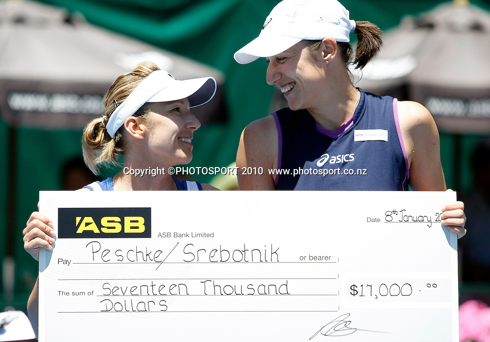 Kveta Peschke (R) and Katarina Srebotnic with the winners cheque after victory in their finals doubles match against Sofia Arvidsson and Marina Erakovic during her final match against at the WTA 2011 ASB Classic, ASB Tennis Centre, Auckland, New Zealand. Saturday 8 January 2011. Photo: Simon Watts/photosport.co.nz