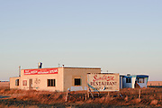 Just as the sun was about to set we drove by this abandoned Sundance Restaurant in southern Alberta, Canada.