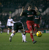 Andy Griffin of Stoke City (right) is penalised for a foul