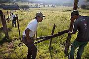 Rancher José Angel Galaviz Carrillo repairs fences with his 22 year old nephew, Rigoberto at his home in the Sierra Mountains near Maycoba, in the Mexican state of Sonora. (From the book What I Eat: Around the World in 80 Diets.)