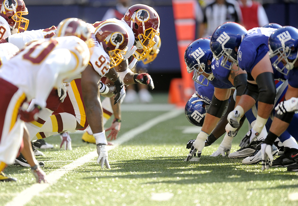 EAST RUTHERFORD, NJ - SEPTEMBER 13: A general view of the line of scrimmage during the snap between New York Giants and the Washington Redskins during their game on September 13, 2009 at Giants Stadium in East Rutherford, New Jersey. (Photo by Rob Tringali) *** Local Caption ***