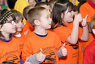 Students perform musical number 'Celebrations' during the dedication of Wright Brothers PK-8 School in Dayton and celebration of the completion of the 10 year Dayton Public Schools building project, Sunday, January 8, 2012.