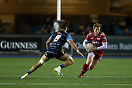 Rhys Patchell of the Scarlets  goes past Cam Dolan of Cardiff Blues (l).  Guinness Pro12 rugby match, Cardiff Blues v Scarlets at the BT Cardiff Arms Park in Cardiff, South Wales on Friday 28th October 2016.<br /> pic by Andrew Orchard, Andrew Orchard sports photography.