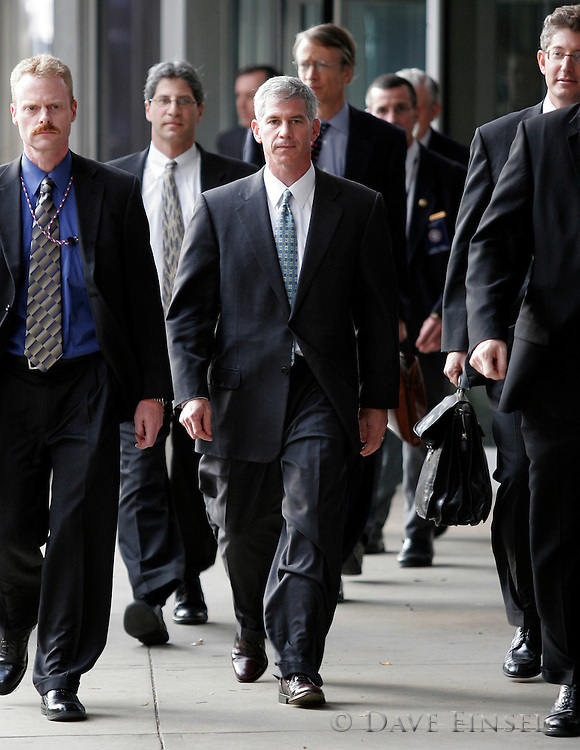HOUSTON  - MARCH 8:  Former Enron chief financial officer Andrew Fastow, center, leaves the Bob Casey United States Courthouse after his second day of testimony, March 8, 2006 in Houston. Fastow, 44, was in control of two Enron partnerships that prosecutors claim were key to the financial facade and central to the fraud charges against former chairman Kenneth Lay and former CEO Jeff Skilling.  (Photo by Dave Einsel)