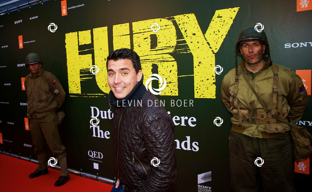 AMERSFOORT - Op de Militaire Basis 'De Bernhardkazerne' is de nieuwe film 'Fury' met acteur Brad Pritt in premiere gegaan. Met hier op de foto  Jan Smit. FOTO LEVIN DEN BOER - PERSFOTO.NU