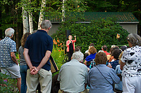 "Senator Elizabeth Warren speaks to the crowd gathered at the home of Edie and Paul DesMarais in Wolfeboro for a ""House Party"" on Wednesday evening.  (Karen Bobotas/for the Laconia Daily Sun)"