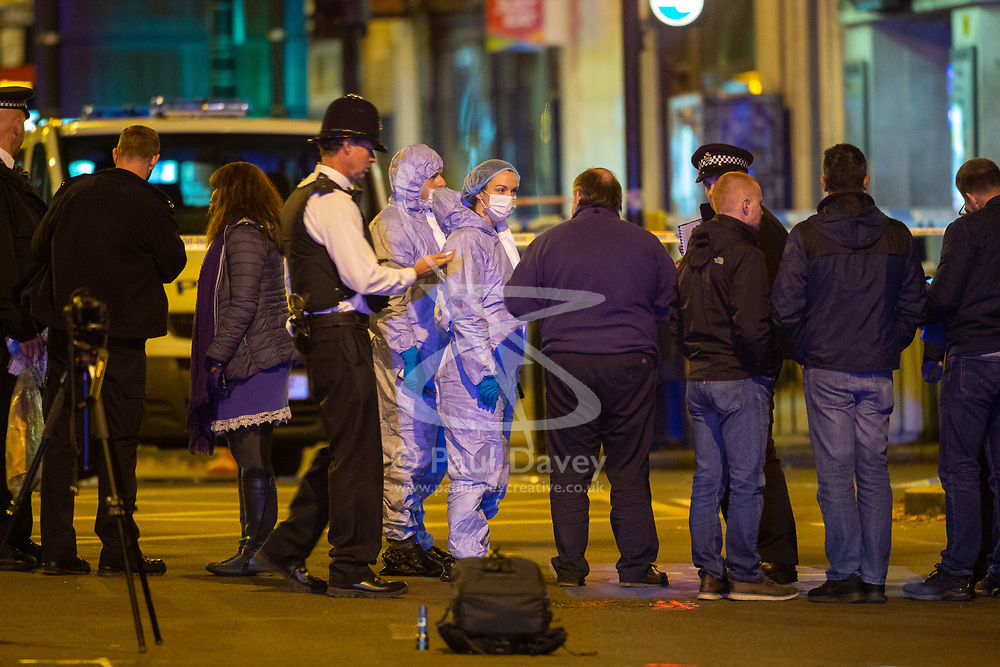 Investigators at the scene where a seventeen-year-old , the second teenager in less than 24 hours, was stabbed and died outside Clapham South Underground Station. Clapham South, London, November 02 2018.