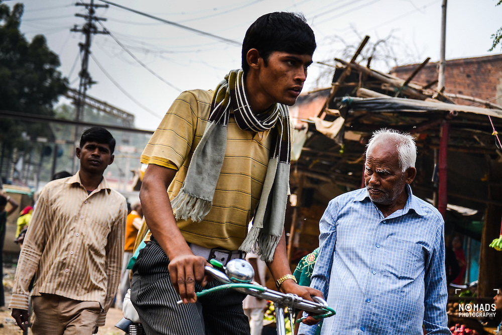 A young cyclist goes about his business in Bodh Gaya, Bihar, India. Bihar is one of the poorest states in India, yet has the fastest growing population. It was once a great centre of power, learning and culture in ancient and classical India. From Magadha arose India's first empire, the Maurya empire, as well as one of the world's most widely adhered-to religions, Buddhism.<br /> <br /> Bodh Gaya is a religious site and place of pilgrimage associated with the Mahabodhi Temple Complex in Gaya district in the Indian state of Bihar. It is famous as it is the place where Gautama Buddha is said to have obtained Enlightenment under what became known as the Bodhi Tree.<br /> <br /> Unlike Buddha I did not gain enlightenment in Bodh Gaya; a crippling stomach illness meant I gained a night at a filthy doctor's surgery on an intravenous drip, and a small bill to go with it.