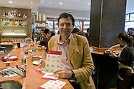 Roma 23 Maggio 2015<br /> La Campagna Slotmob contro la diffusione del gioco d'azzardo legalizzato a organizzata una marcia nel quartiere Tiburtino consegnando degli adesivi ai bar slot-free che hanno rinunciato agli introiti dell'azzardo per un puro gesto di responsabilità, e che sono stati premiati, con una colazione di massa,  dei partecipanti alla marcia. Leonardo Becchetti,docente di Economia politica presso l'Università Tor Vergata di Roma e cofondatore di SlotMob.<br /> Rome May 23, 2015<br /> Campaign Slotmob against the spread of legalized gambling in a march organized in the district Tiburtino delivering stickers to bar slot-free that they gave up to the revenue of chance for a pure gesture of responsibility  and have been rewarded with a Breakfast mass of marchers. Lorenzo Becchetti, Professor of Political Economy at the University of Rome Tor Vergata and co-founder of SlotMob.